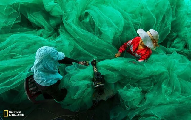 In Vinh Hy Bay, two women become lost in the fabric of a fishing net. That was just a random moment when I came to the fishing village to shoot the lifestyle of the fisherman. While the men do their fishing, their wives stay at casa and do the errands. When we were there, the ladies were sewing the fishing net for a new fishing season.