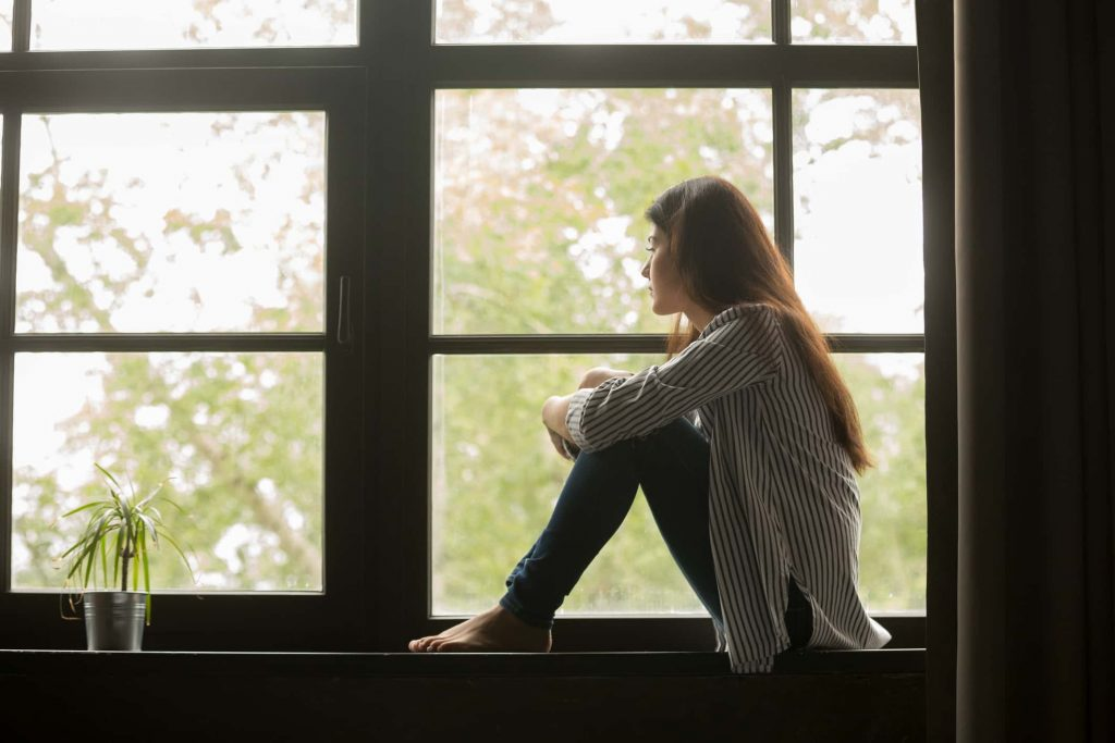 Sad Girl Death Wallpaper Thoughtful Girl Sitting On Sill Embracing Knees Looking At