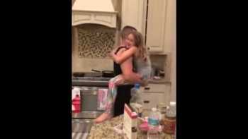 Dad Dances With Daughter In The Kitchen