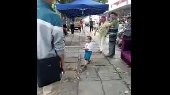 Chinese Toddler Uses Metal Pole To Defend Grandma From Police