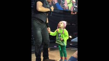 Bruce Springsteen Invites Little Girl On Stage During Concert