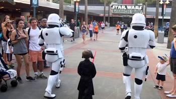 Storm Troopers Escort Kid Dressed As Kylo Ren