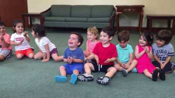 Toddler's Hysterical Laughter Is Adorably Infectious For Entire Class