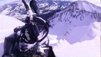 Snowmobiler Almost Falls Off Cliff