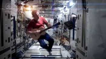"""Chris Hadfield Covers David Bowie's """"Space Oddity"""" On International Space Station Music Video"""