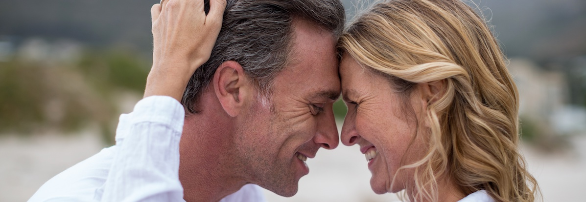 Mature couple embracing each other on the beach  Virginia