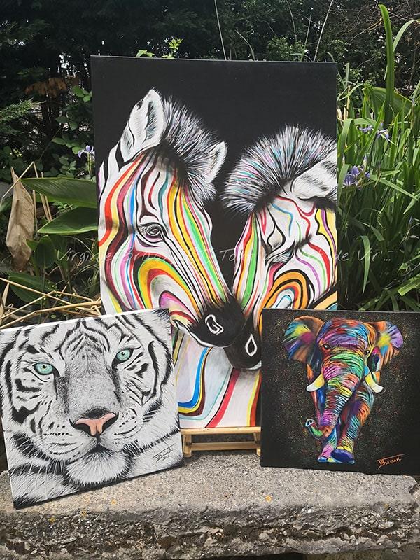 Trois tableaux d'animaux de la jungle colorés etpeints à l'acrylique