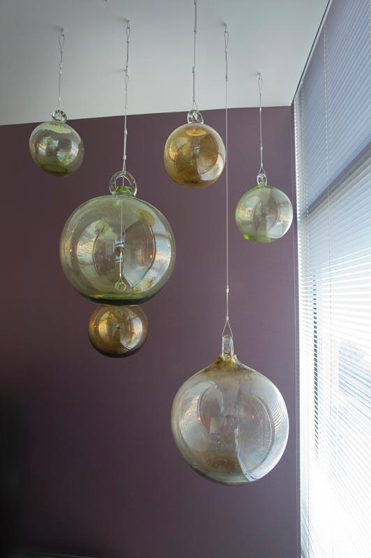 kitchen and bathroom remodeling aid range hood hanging glass balls - interior designer denver co