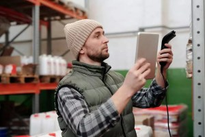 Inventory Management taking place with RFID scanner and tablet