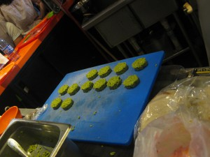 Green (yes green!) felafel discs waiting to be fried