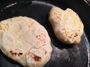 The far pita is in the process of puffing - the trick is a VERY HOT pan