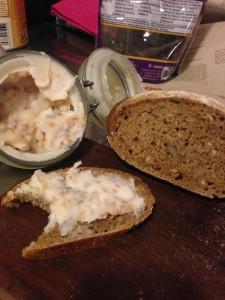 Sourdough rye bread, grieben schmaltz in the jar and on the bread.