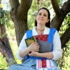 Emma Watson Belle 2017 Live Action Blue Peasant Dress Sitting with Trees