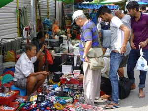 Men haggle over the price of swap meet goods like marketers looking for a big social media roi.