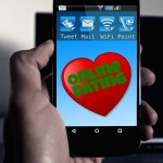 """Cell phone with image of heart and words """"Online Dating""""."""