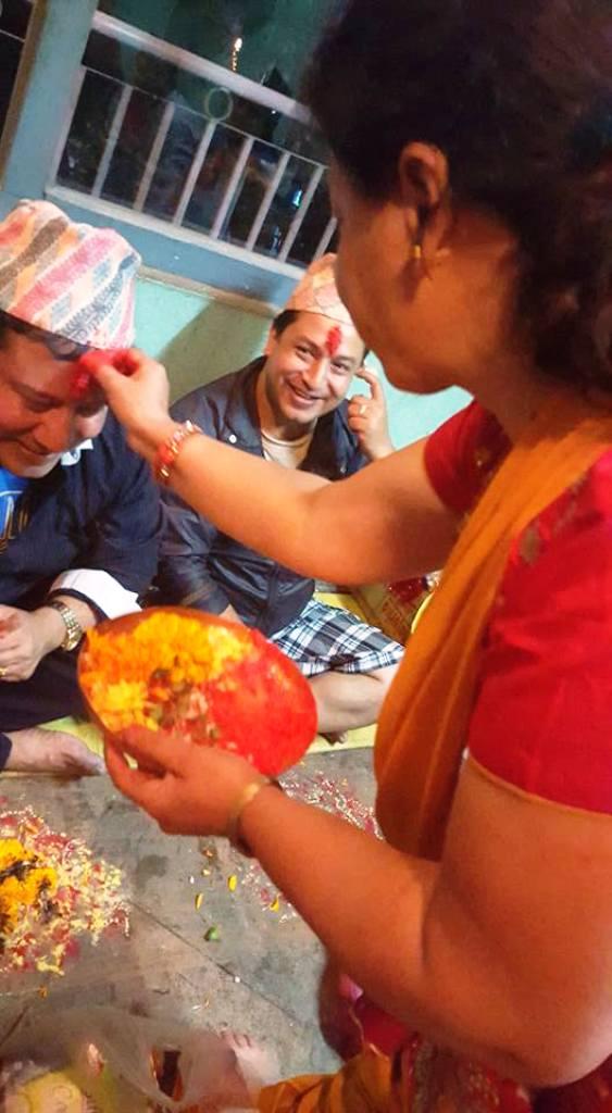Bhaiteeka giving Artist Manish Kumar Shrestha and his brother Satish Kumar Shrestha with their Sisters.