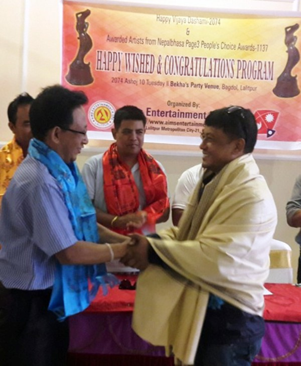 Shyam Smrit awarded Special Journalism Award. Award give hand over by Fist Nepal Bhasha Journalist Bijay Ratna Asabare.