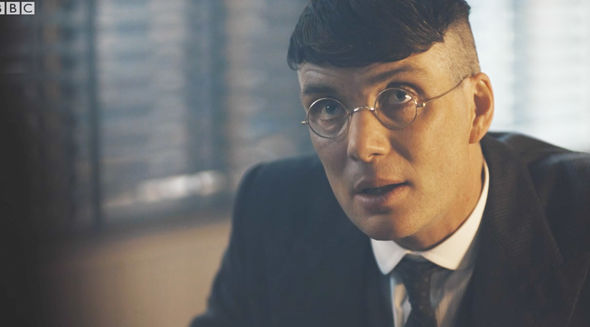 Thomas Shelby (Cillian Murphy) with round metal glasses