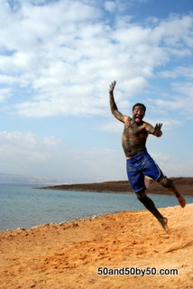 me jumping while covered in Dead Sea mud