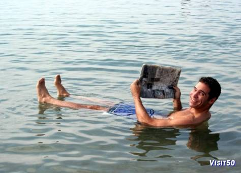 me - Dead Sea in Jordan closeup - Look closely and you'll see I'm reading a Japanese newspaper!