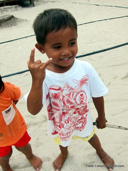 Original Baby Rockstar perfects a new pose - helping this little boy is an example of why i love to travel