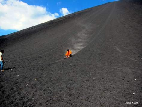 Volcano boarding! The beginning of the volcano sledding experience is very fast!