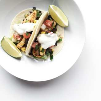 Fish tacos in Hawaii with salsa and limes.