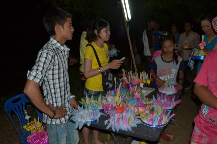 Villagers buy Loy Pratip (floating candle boats) used to offer prayers, good luck and wishes for the next year