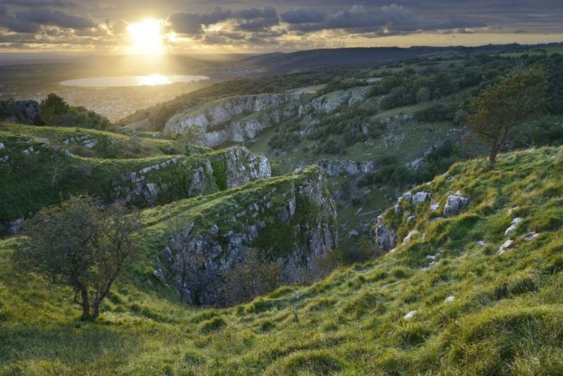 View of the sun breaking through the clouds at Cheddar Gorge in the Mendip Hills