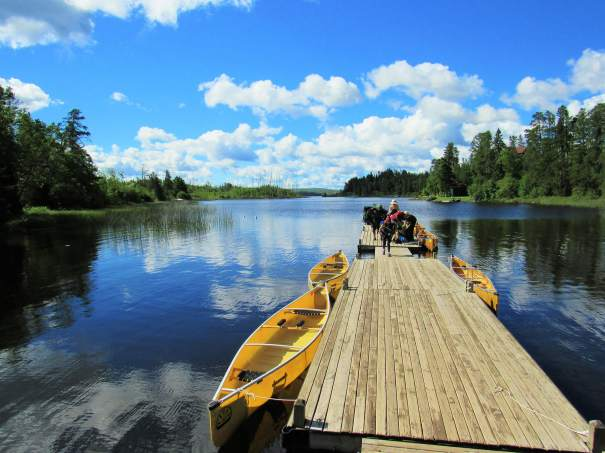 Canoes are ready to be taken out from dock onto lake at Seagull Canoe Outfitters & Cabins