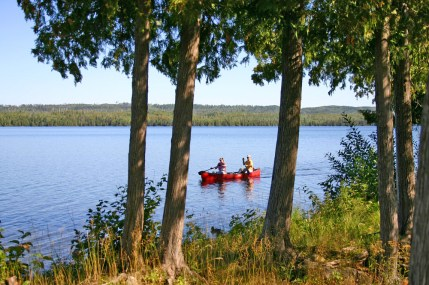 Gunflint Lodge Couple paddling in red canoe