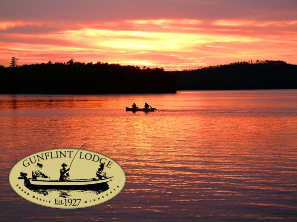 Gunflint Lodge Outfitters canoe sunset with logo