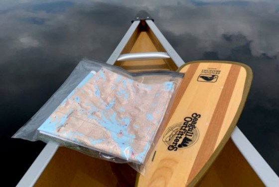 Seagull Outfitters paddle with map