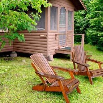 Tuscarora Lodge & Canoe Outfitters adirondack chairs outside cabin
