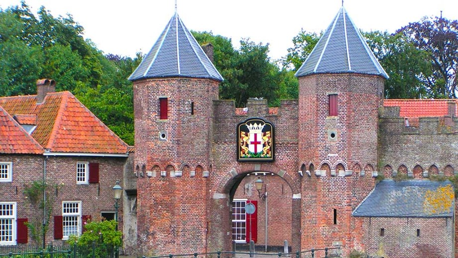 A view on an old medieval city gate with a river in Amersfoort, The Netherlands