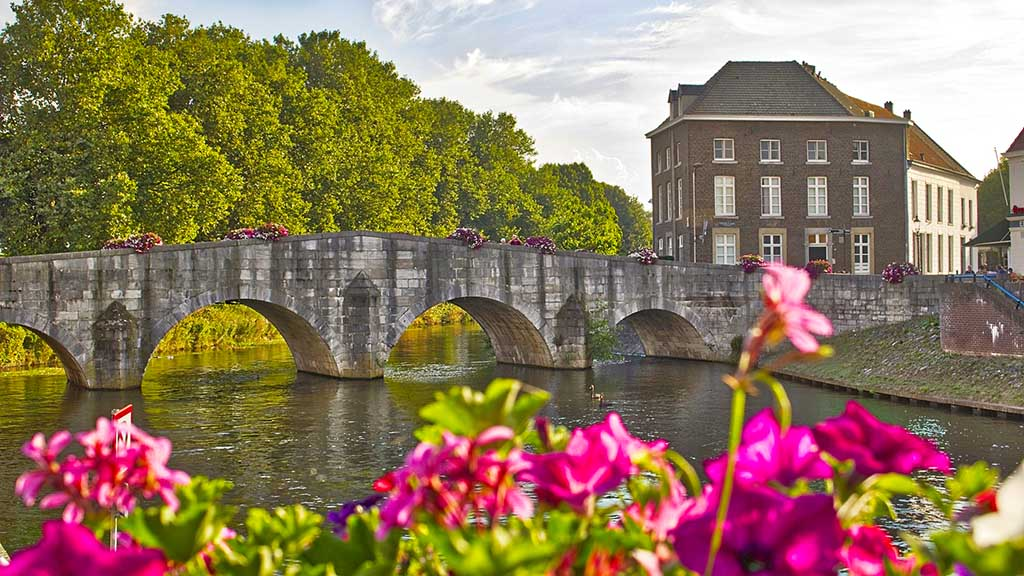 a view on a historic bridge and a canal in the city of Roermond, The Netherlands