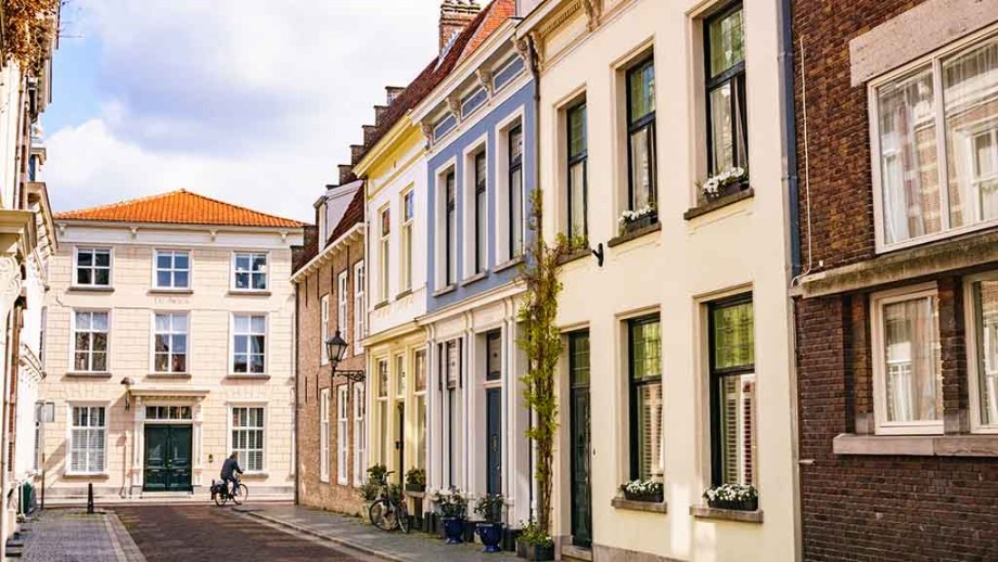a view on a cyclist going through a cobblestoned street in Bergen op Zoom, The Netherlands