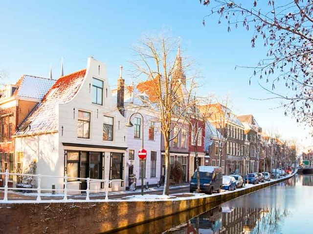 A view on delft and its canals during winter