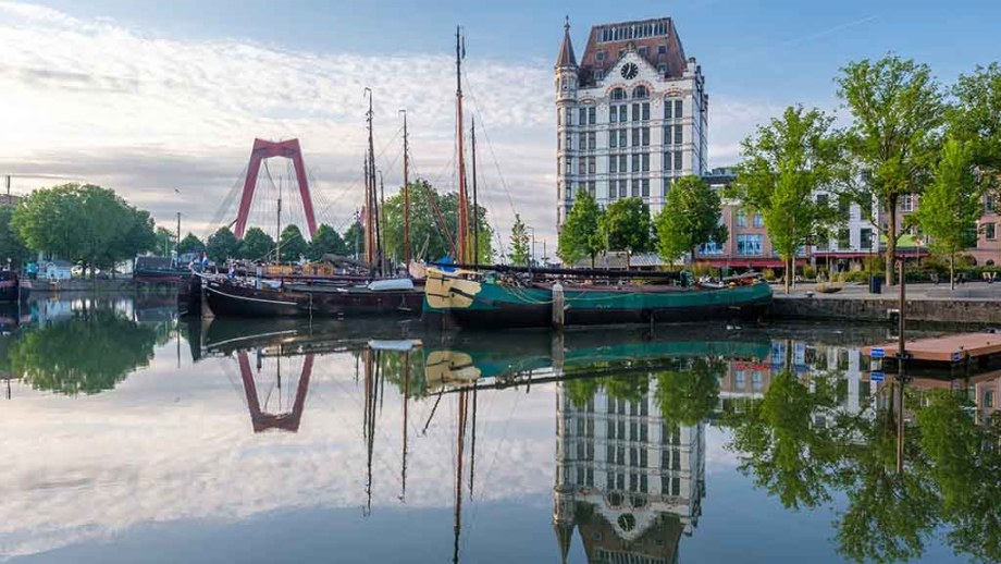 The old harbour, oude haven, in Rotterdam with the Witte Huis (first skyscraper in Europe) in the background