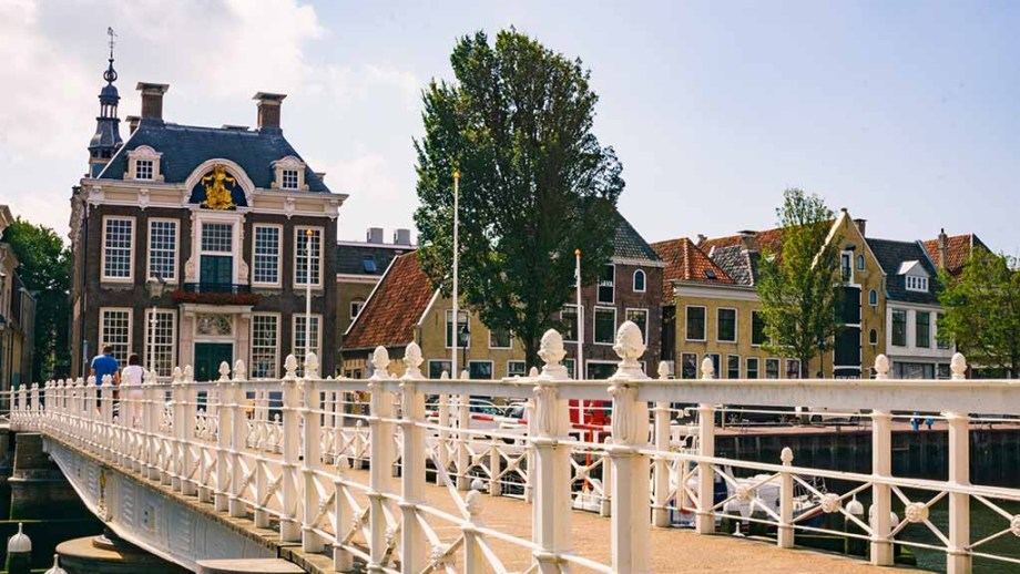 A view on a bridge and old Dutch Frisian houses in Harlingen, The Netherlands
