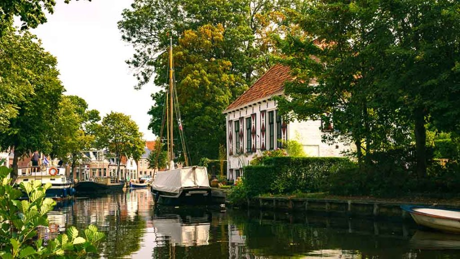 view on canal and canal houses in the Dutch village of Aldeboarn, The Netherlands