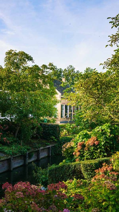 A spectacular view on gardens next to the river in the village of Drimmelen, The Netherlands