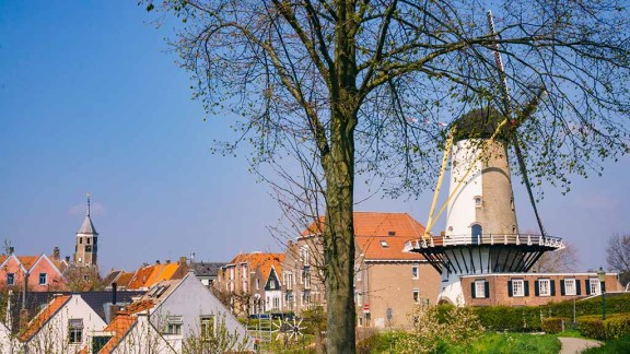 A view on an old Dutch windmill seen from fortifications in Willemstad, The Netherlands