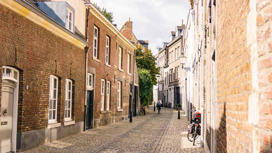 Cobblestoned street and historic buildings in city Maastricht, The Netherlands