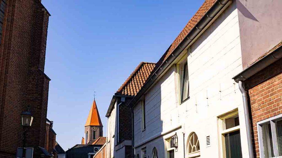 A photo of an orange church tower