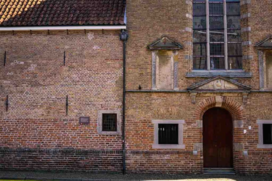 a photo of the bottom part of an old brick church in the town of Montfoort, The Netherlands