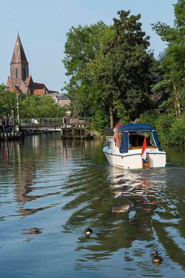 A photo of a motorboat in sailing in the town of Montfoort, The Netherlands