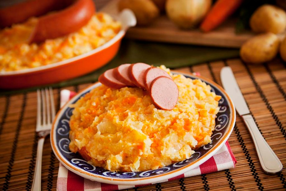 'Hutspot met worst' - a traditional Dutch dish with mashed potatoes, carrots, onions and smoked sausage.