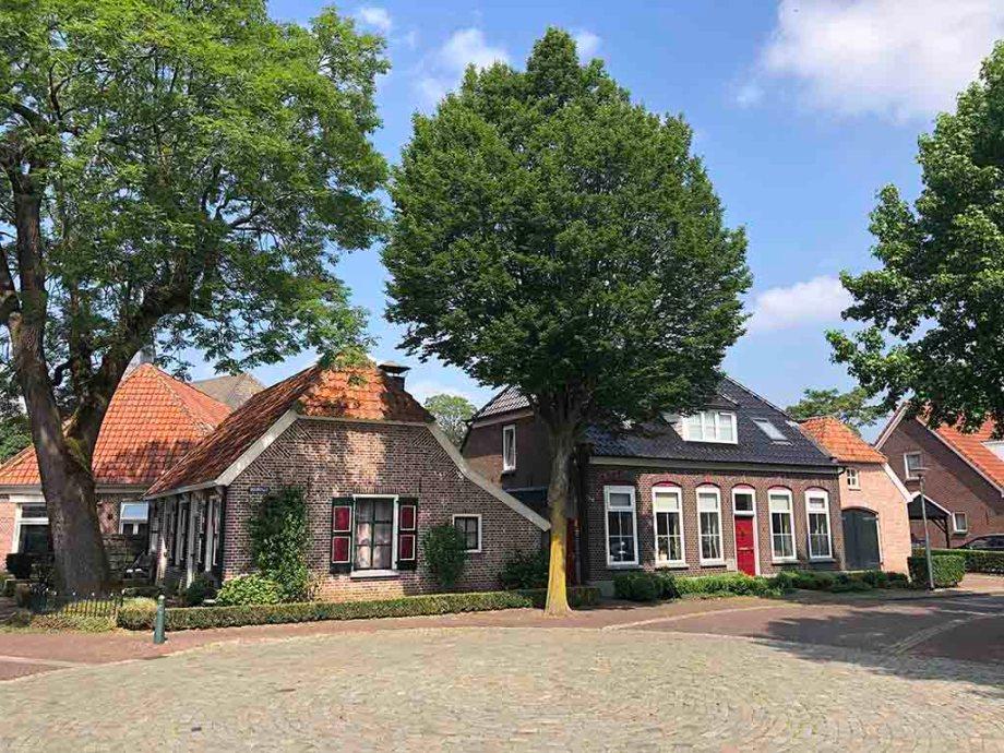 Old Dutch brick houses on a square in Gramsbergen Overijssel The Netherlands