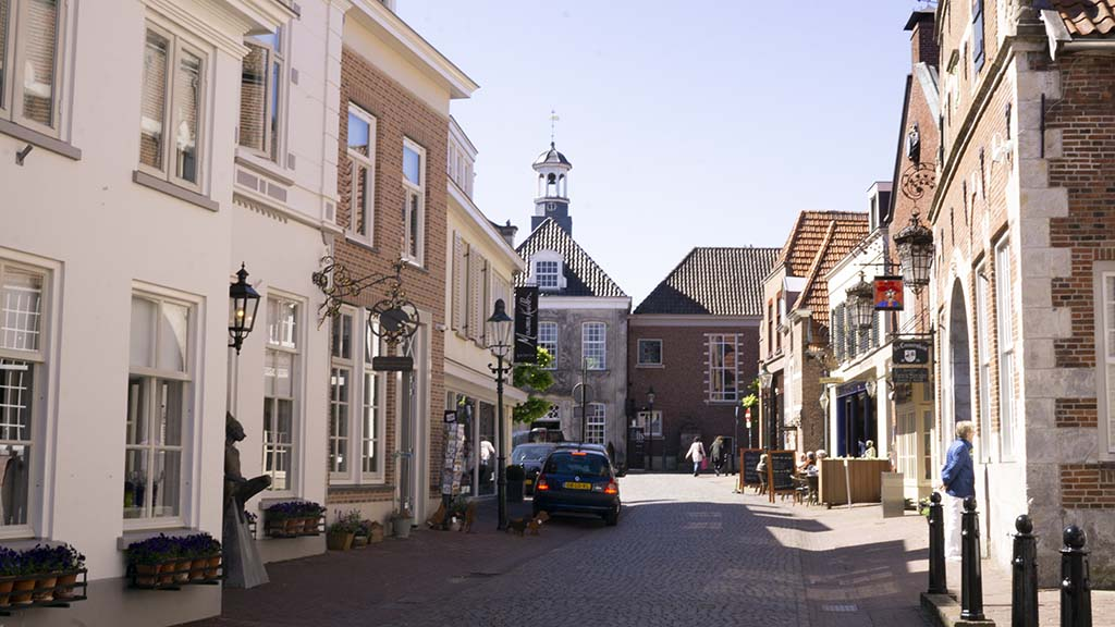 A view on the former town hall of the village of Ootmarsum from a cobblestoned street